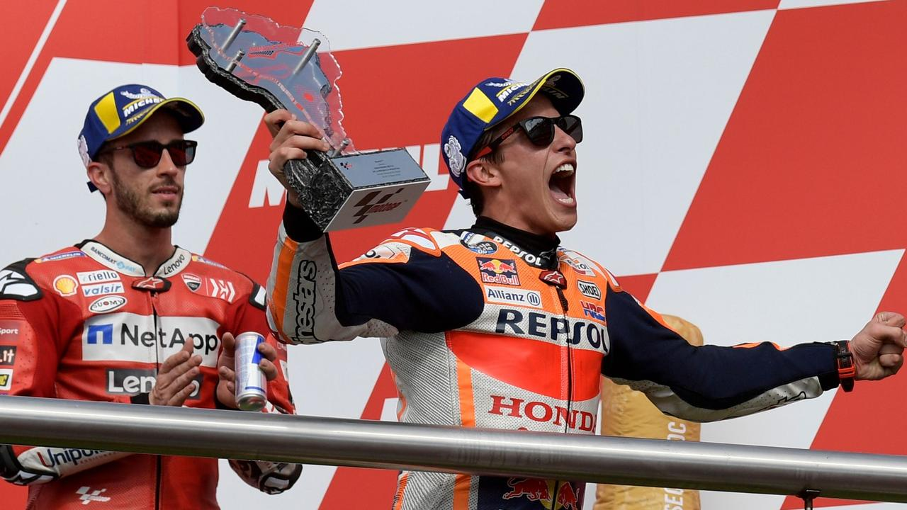 Andrea Dovizioso (L) must be getting sick of seeing Marc Marquez win.