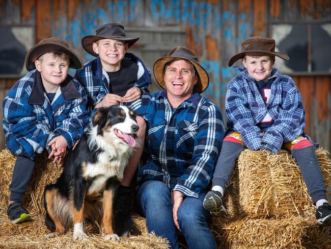 Melbourne show ambassador Shane Crawford with sons Harry, 7, Ben, 10, and Jack, 7. Picture: Mark Stewart