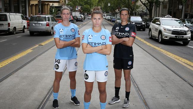 City skipper Stephanie Catley with defender Alanna Kennedy (left) and goalkeeper Lydia Williams in Collins St. Picture: Michael Klein