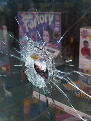 A bullet hole in a shop window from the shooting of Willie Thompson.