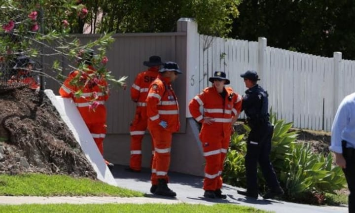 Police and SES search the street in Greenslopes as part of the murder investigation.Source:News Corp Australia