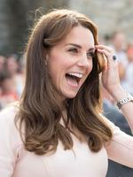 SEE the moment Kate caught the eye of construction workers in Cornwall before she poured a pint with Wills ...