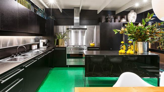 A green floor in the modern kitchen makes a statement.
