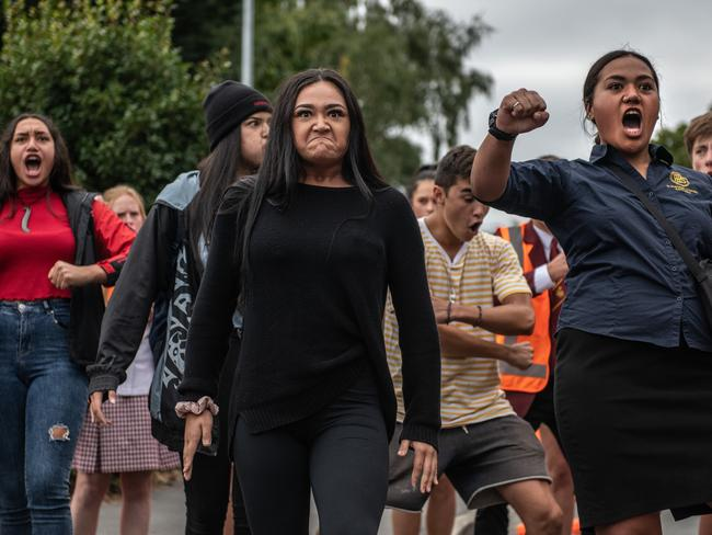 Students from different schools joined together to perform the traditional dance. Picture: Carl Court/Getty Images