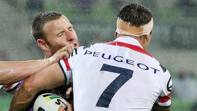 Blake Green is tackled by Mitchell Pearce.