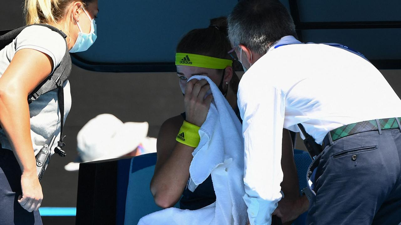 Czech Republic's Karolina Muchova (C) receives medical attention at a crucial juncture of her clash with Ash Barty.