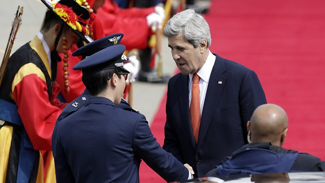 U.S. Secretary of State John Kerry, right, shakes hands with unidentified South Korean Air Force soldiers upon his arrival at Seoul military airport in Seongnam, South Korea, on the first leg of his three-nation Asian tour. (AP Photo/Lee Jin-man)
