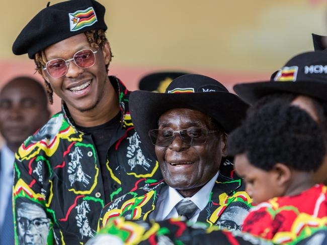 Robert Mugabe with his son Robert Jr, and his grandson during his 93rd birthday celebrations in February. Picture: Jekesai Njikizana/AFP