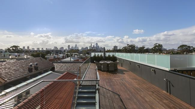 The home's large rooftop terrace offers views of the city and bay.