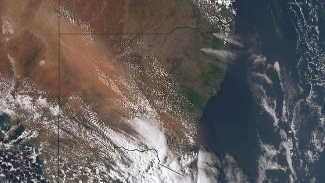 Dust can be seen as the lighter brown haze in an uneven line through New South Wales. Picture: Bureau of Meteorology.