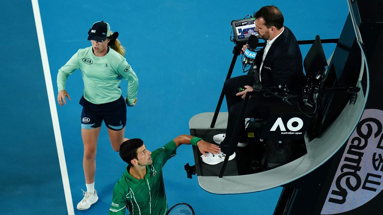 Djokovic touches the chair umpire, which is not allowed. (AAP Image/Dave Hunt)