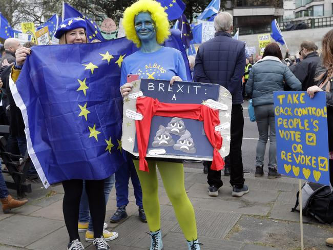 Demonstrators pose for photos while waiting for the start of a Peoples Vote anti-Brexit march in London, Saturday, March 23, 2019. Picture: AP Photo/Kirsty Wigglesworth