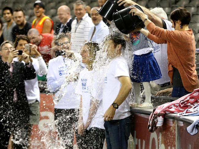 Angie and Pat Cunningham were the first to get drenched at the Ice Bucket Challenge world record attempt at Etihand Stadium in 2014. Picture: Tim Carrafa