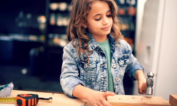 Shot of a cute little girl playing with tools