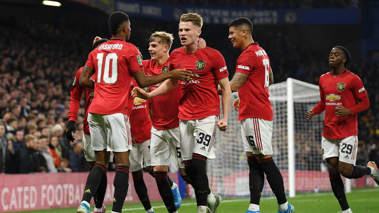 Rashford is mobbed by his Manchester United teammates