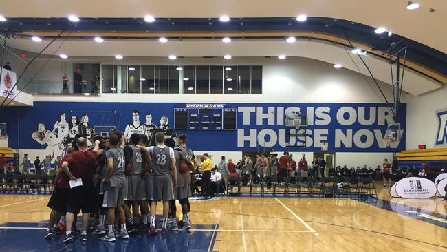 Players huddle at the NBA Basketball Without Borders camp
