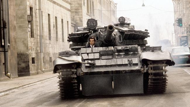Pierce Brosnan driving a tank like a boss in GoldenEye. Picture: Everett Collection