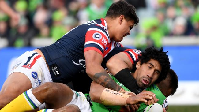 Canberra's Sia Soliola is crucnched by the Roosters in the hard-fought loss last weekend.
