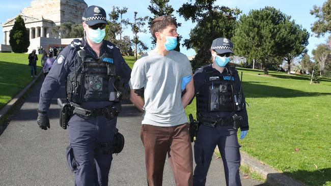 Police arrest a man after he refused to put on a mask at the Shrine of Remembrance earlier in the morning. Picture: NCA NewsWire /David Crosling