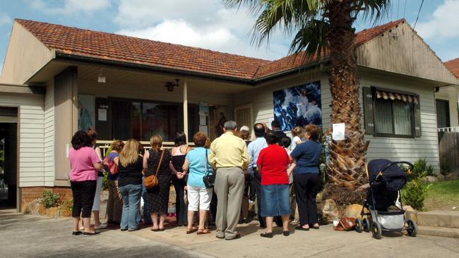 """People still queue to view the weeping walls in the """"Miracle House""""."""