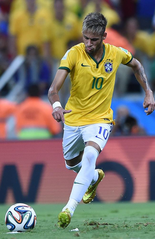 Brazil's forward Neymar takes a freekick during the quarterfinal against Colombia.