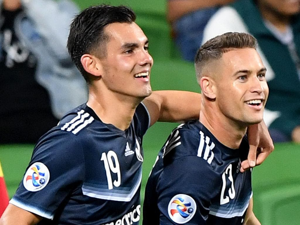 Jai Ingham of Victory is congratulated by team mate Pierce Waring (left) after scoring a goal during the AFC Champions League Group F match between Melbourne Victory of Australia and Shanghai SIPG of China at the Melbourne Rectangular Stadium in Melbourne, Wednesday, April 18, 2018. (AAP Image/Joe Castro) NO ARCHIVING, EDITORIAL USE ONLY