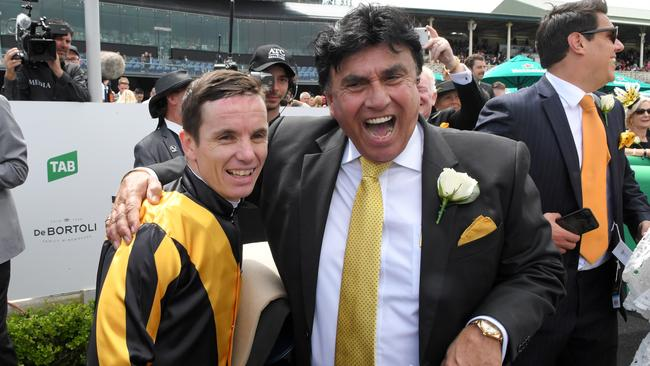 Owner Bert Vieira with jockey Tim Clark after I Like It Easy's victory. Picture: AAP