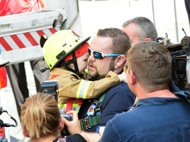 "Alex Tann hugs his dad Phil after the ""city rescue"" in February."