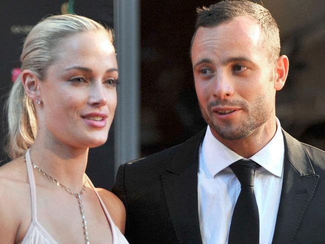 South African Paralympian athlete Oscar Pistorius posing next to his girlfriend Reeva Steenkamp. Picture: AFP