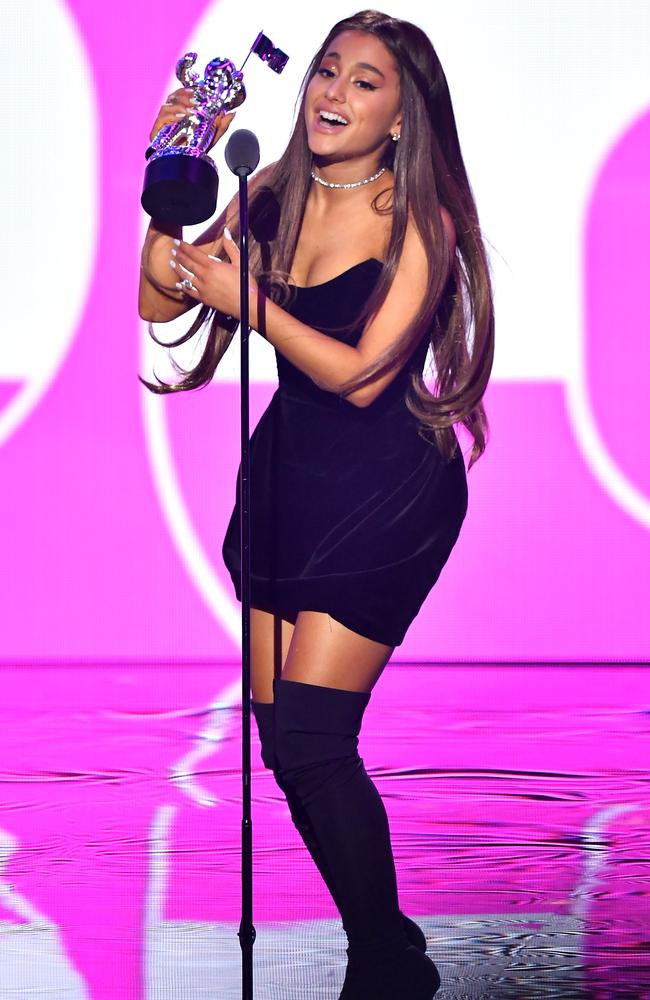 Her moment! Ariana Grande accepts the award for Best Pop onstage during the 2018 MTV Video Music Awards.