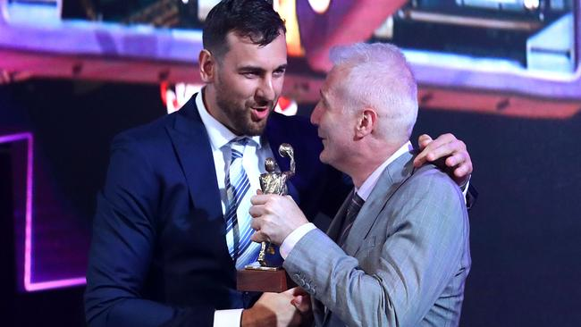 Andrew Bogut receives the NBL Most Valuable Player Award from Andrew Gaze.