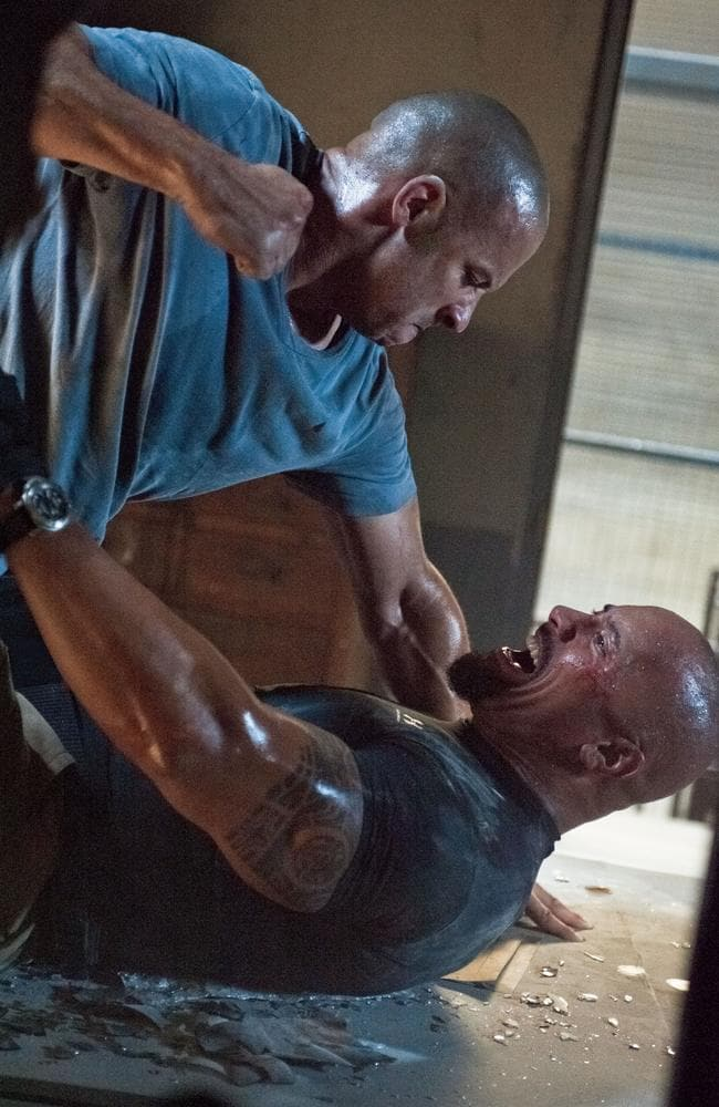 Vin Diesel and Dwayne Johnson let the fists fly in a scene from film <i> Fast &amp; Furious 5</i>.