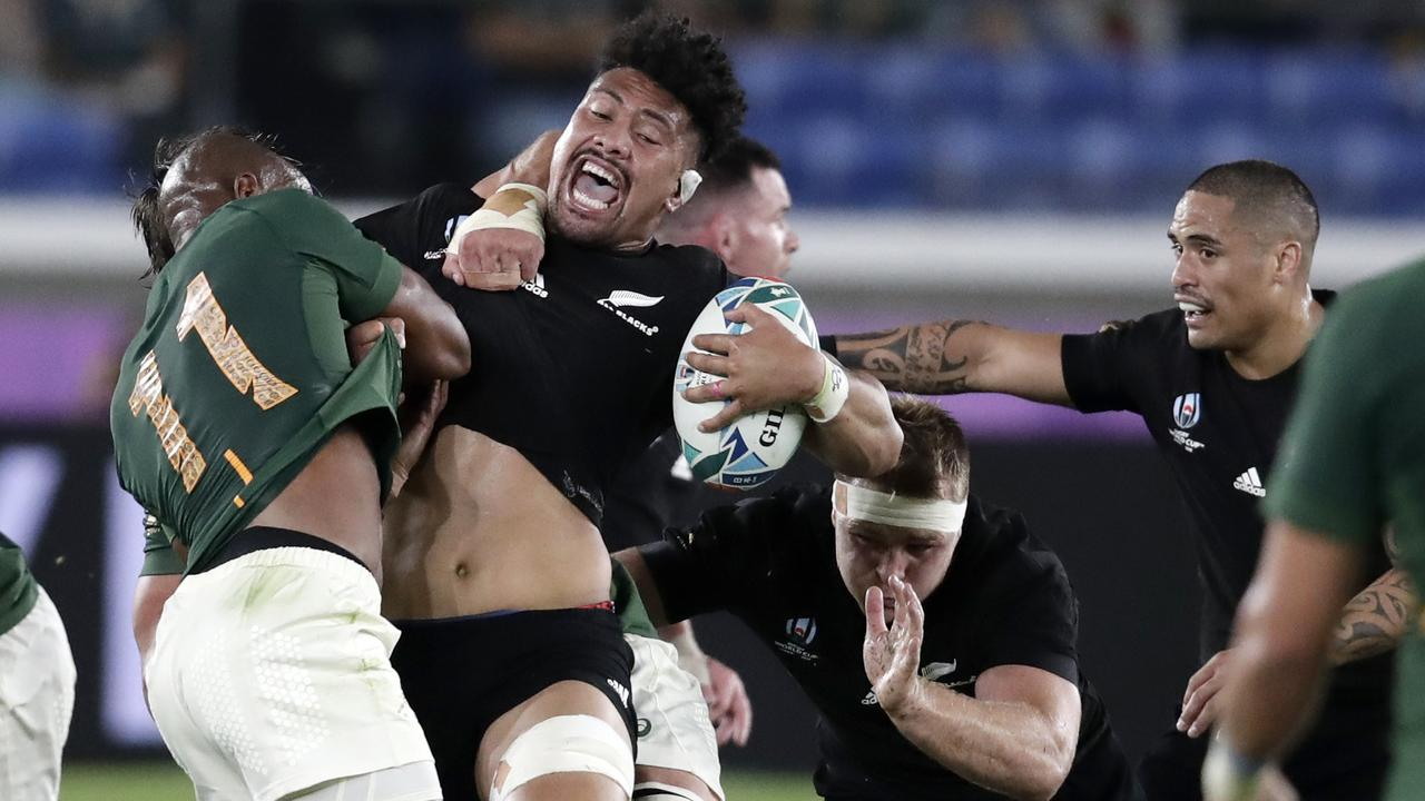 New Zealand's Ardie Savea reacts as he is tackled by South Africa's Makazole Mapimpi.