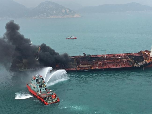Black smoke billows from an oil tanker after it caught fire off southern Lamma island of Hong Kong. Picture: AP