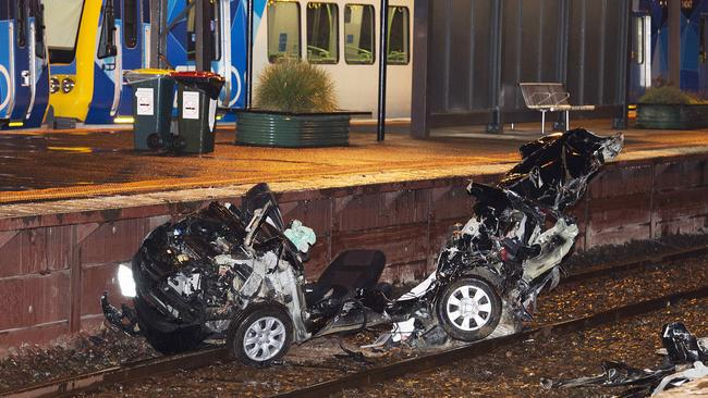 The car was dragged 150m down the track by the train coming to a rest at Surrey Hills station. Picture: Ellen Smith