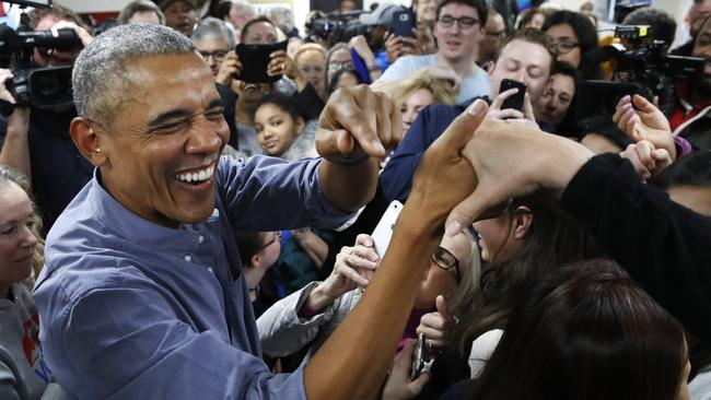 Former President Barack Obama smiles as he greets Democratic volunteers in a surprise appearance. Picture: AP