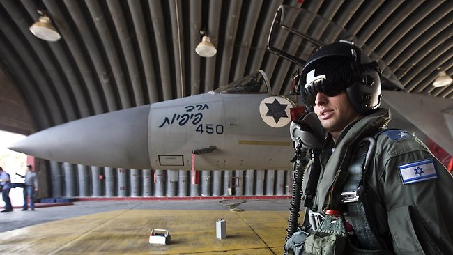 An Israeli pilot readies to climb into the cockpit of an F-15 Eagle fighter jet at an Israeli Air Force Base. Picture: AFP