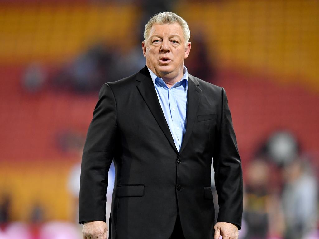 Television commentator Phil Gould is seen during the Round 22 NRL match between the Brisbane Broncos and the Penrith Panthers at Suncorp Stadium in Brisbane, Friday, August 16, 2019.  (AAP Image/Darren England) NO ARCHIVING, EDITORIAL USE ONLY