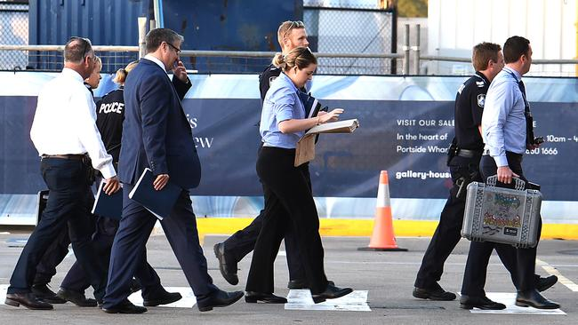 Police arrive at the terminal as P&O Pacific Dawn docks at Portside wharf in Brisbane after a woman fell overboard off the coast of New Caledonia. Picture: AAP/ John Gass.