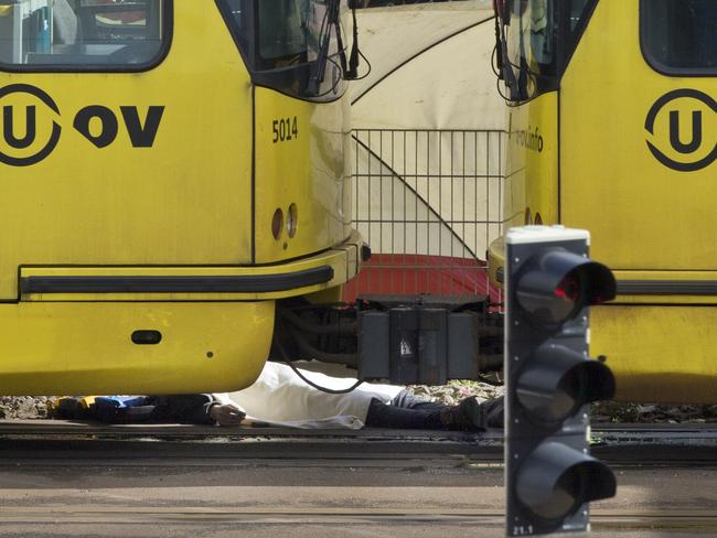 A body is covered with a blanket next to a tram following a shooting in Utrecht, Netherlands. Picture: AP