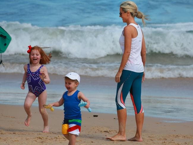 Roxy Jacenko with children Pixie and Hunter at Bondi Beach on Father's Day while her husband Oliver Curtis is in jail. Picture: Cameron Richardson