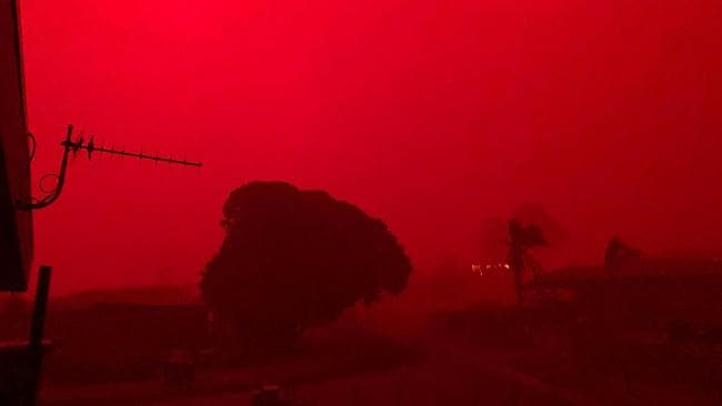 A red sky as bushfires approach Mallacoota in East Gippsland. Picture: Twitter/@brendanh_au