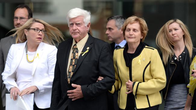 Parents of Alison Baden-Clay, Geoff and Priscilla Dickie dressed in their daughter Allison's favourite colour yellow, come out of the Supreme Court in Brisbane where Gerard Baden-Clay was found guilty of murdering his wife. (AAP Image/Dan Peled).