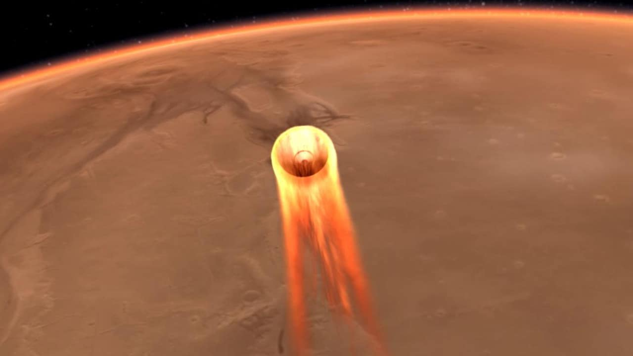 This artist's impression obtained from NASA shows InSight's entry, descent and landing at Mars. Picture: AFP PHOTO / NASA/JPL-Caltech