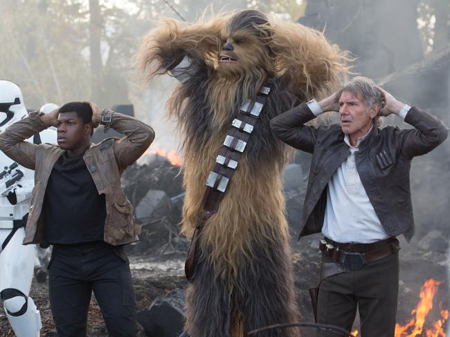 We've played this scene before ... Finn, played by John Boyega, with Chewbacca and Han Solo in a scene from the new movie. Picture: Lucasfilm