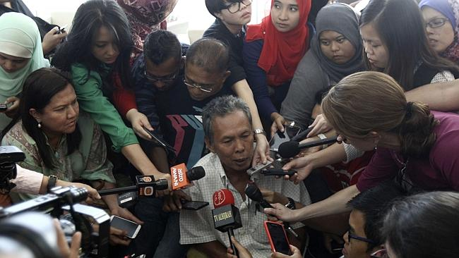 Selamat Omar, whose son Khairul Amri was on MH370, speaks to journalists after the Malaysian PM's press conference. Picture: AP