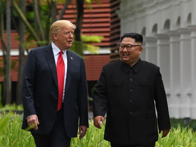 Kim Jong-un walks with US President Donald Trump during a break in talks at their historic US-North Korea summit. Picture: AFP