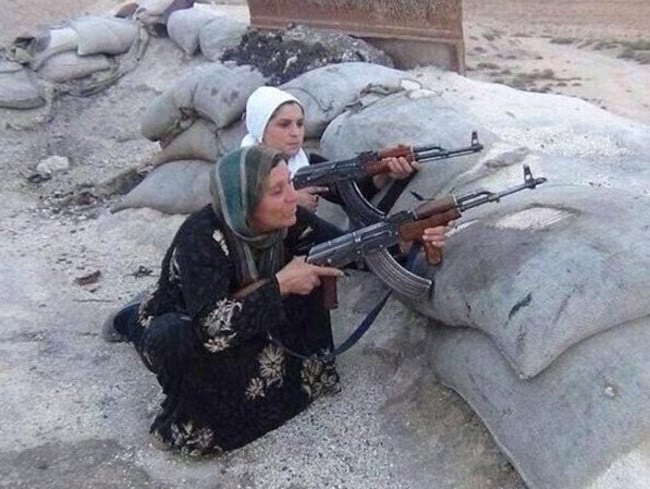 In the trenches ...Kurdish women take on IS terrorists in Kobane. Pic: Twitter