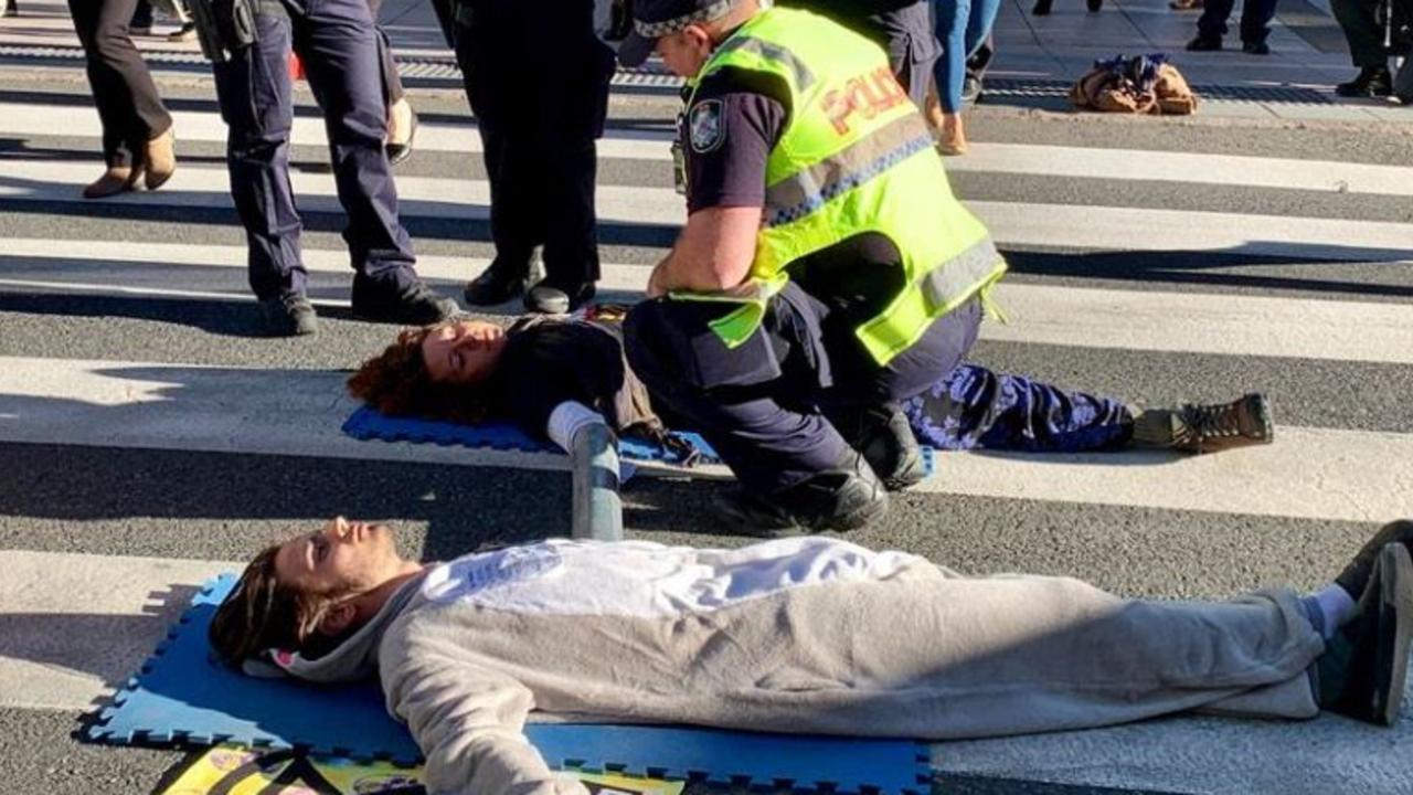 'Totally unnecessary': Protesters stop traffic in CBD stunt