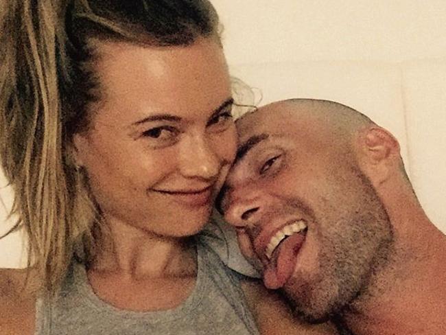 Behati Prinsloo with her now-bald husband Adam Levine.